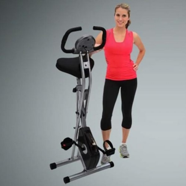 best Upright Exercise Bike - woman standing next to it